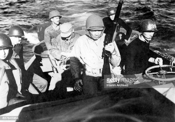 View of United States Coast Guard commander Jack Dempsey and his crewmates in a landing craft as they head for the beach Okinawa Japan April 13 1945