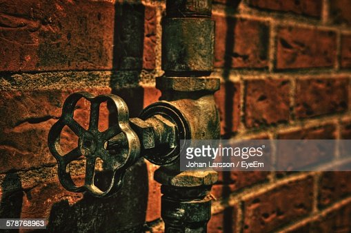 View Of Valve Against Red Brick Wall