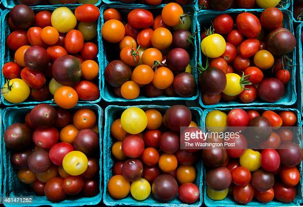 View of varigated cherry tomatoes at a farmer's market outside the Frank D Reeves Municipal Center in Washington DC on August 2 2014 The DC City...