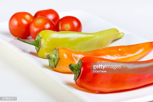 View of vegetables on a plate, white background