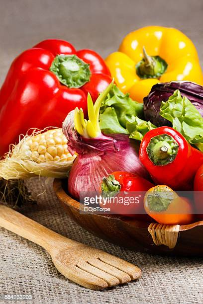 View of vegetables on a wood plate