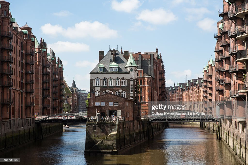 View of warehouse waterfront and bridges, HafenCity, Hamburg, Germany