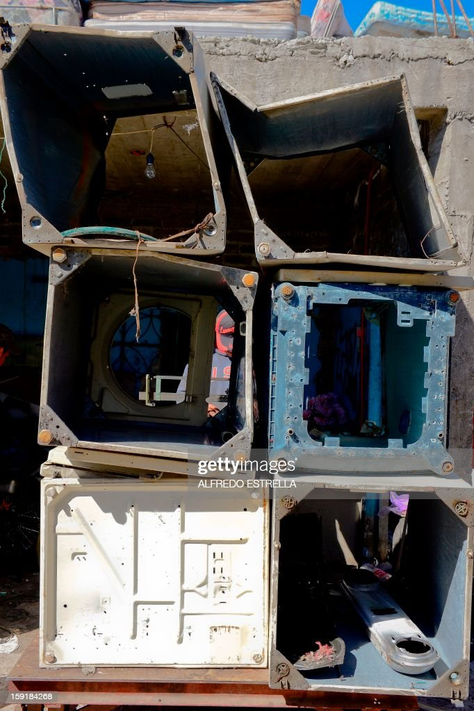 View of washing machines parts on the Recycling Center at Nezahualcoyotl, State of Mexico, on January, 09, 2013. AFP PHOTO/Alfredo Estrella