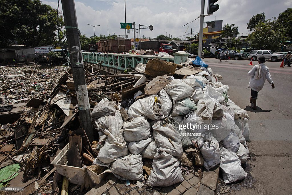 A view of waste that was piled up by the flood at Pakin river in North Jakarta on January 26, 2013 in Jakarta, Indonesia. With heavy rain forecast for January 26-28, Indonesian authorities have organised the use of generators and cloud-seeding measures to defuse rain-laden clouds to help prevent further flooding of Jakarta, following last week's floods which claimed the lives of 32 people.