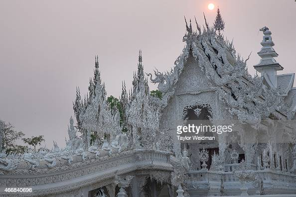 A view of Wat Rong Khun at sunset on March 19 2015 in Chiang Rai Thailand After an incident last month Wat Rong Khun refused entry to Chinese...