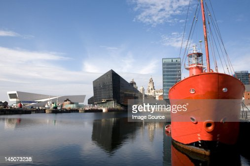 View of waterfront towards Museum of Liverpool and Royal Liver Building, Liverpool, UK