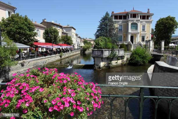 A view of waterside cafes and restaurants along the river Sorgue on August 12 2012 in Isle sur la Sourge Provence France Isle sur la Sourge is famous...