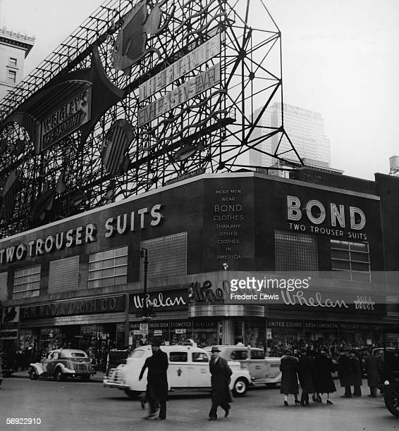 View of West 44th Street on Times Square New York New York 1930s The large billboard advertises Wrigley's chewing gum Visible storefronts include...