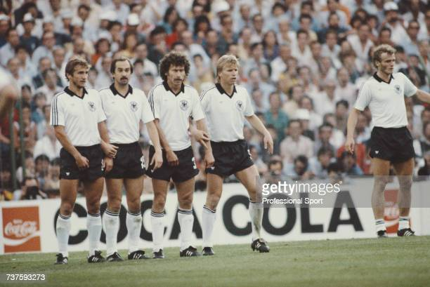 View of West Germany national football team players making a defensive wall prior to an Italy free kick in the 1982 FIFA World Cup Final between...