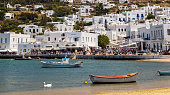 Beautiful view of Mykonos harbour and white town on a sunny day.