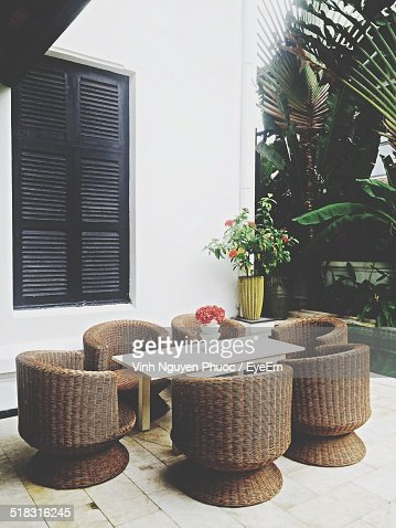 View Of Wicker Chairs Around Table