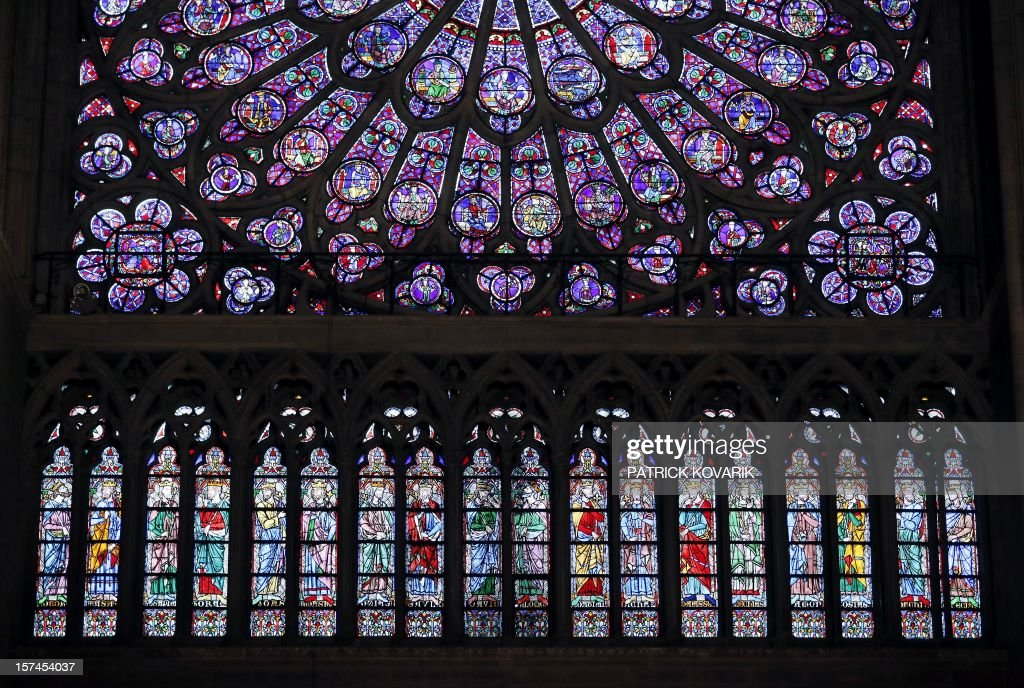 A view of windows below the middle-age stained glass rosace on the northern side of the Notre-Dame de Paris cathedral, on November 29, 2012, in Paris.
