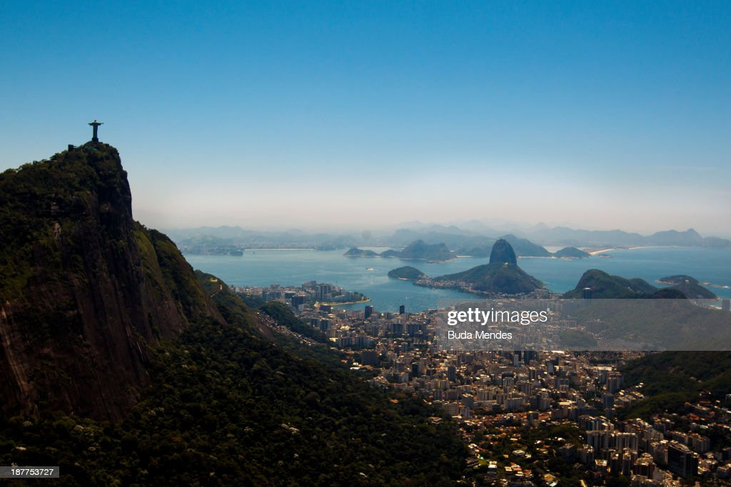 View of with Christ the Redeemer (L) and Sugar Loaf at background on November 12, 2013 in Rio de Janeiro, Brazil.