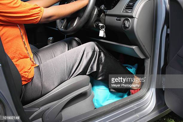 View of woman in drivers seat with hand bag by feet, Johannesburg, South Africa