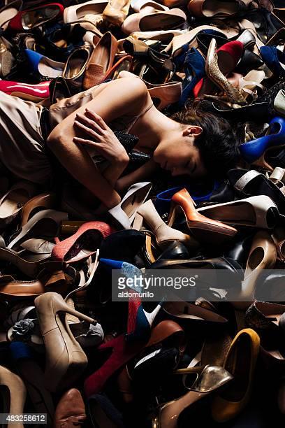 View of woman sleeping on high heels