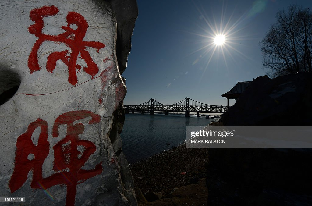 View of words from a Chinese poem beside the Sino-Korean Friendship bridge that links the North Korean town of Sinuiju with the Chinese town of Dandong on February 10, 2013. US Secretary of State John Kerry warned that North Korea's expected nuclear tests only increase the risk of conflict and would do nothing to help the country's stricken people. The country has vowed to carry out a third nuclear test soon, and concerns have been raised over the type of fissile material used in the device. AFP PHOTO/Mark RALSTON
