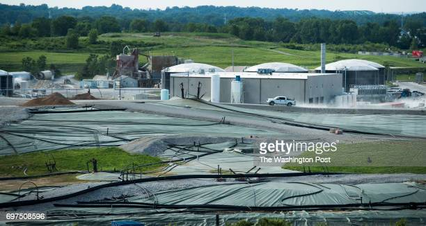 View of workers who are covering and trapping potential airborne debris and gasses on a portion of the West Lake Landfill in the greater St Louis MO...