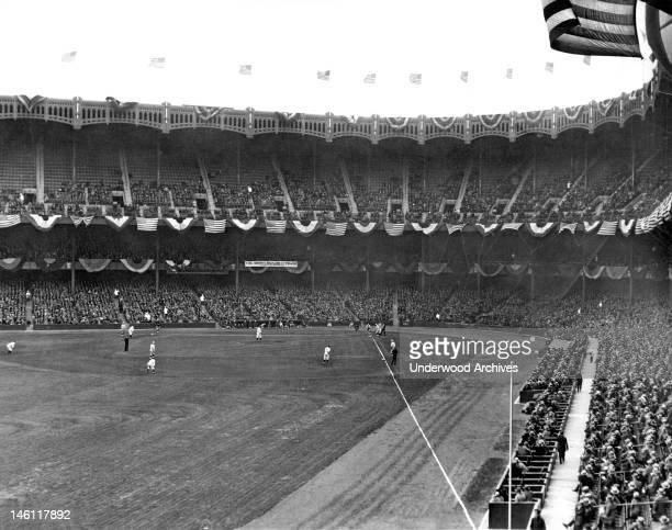 A view of Yankee Stadium and the fans watching the Yankees play New York New York mid 1920s