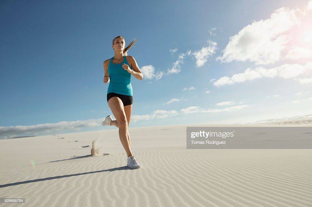 View of, young adult woman jogging : Foto de stock