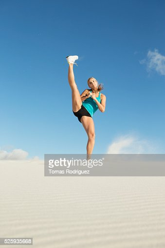 View of, young adult woman, stretching leg : Foto de stock