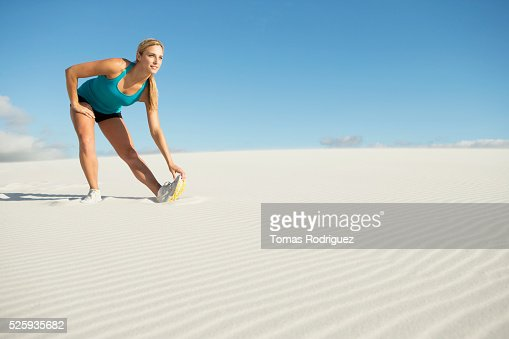 View of, young adult woman, stretching leg : Stock Photo