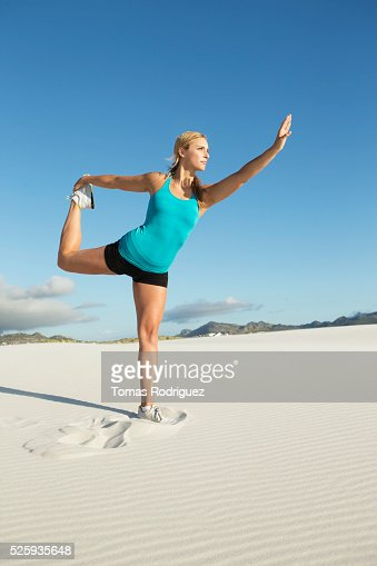 View of, young adult woman, stretching : Photo