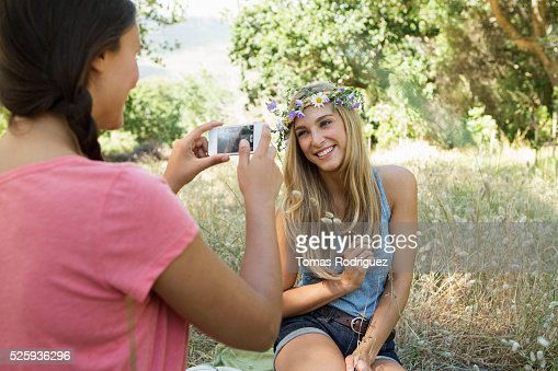 View of young adult woman taking photo : Stock Photo
