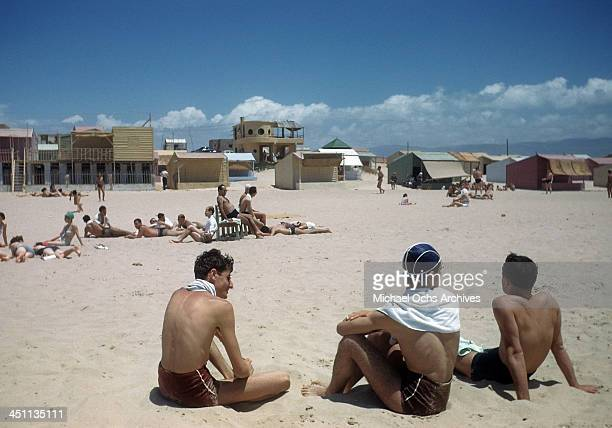A view of young boys resting on a beach in Beirut Lebanon