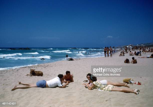 A view of young couples resting on a beach in Beirut Lebanon