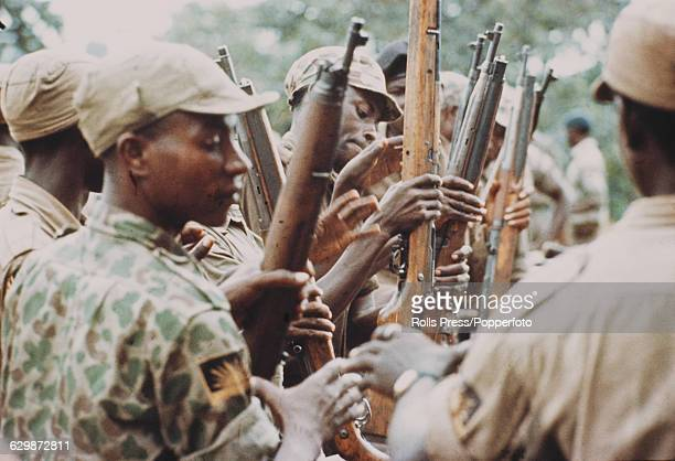 View of young men and soldiers from the Republic of Biafra undergoing basic training with rifles before being sent to fight in the Nigerian Biafran...