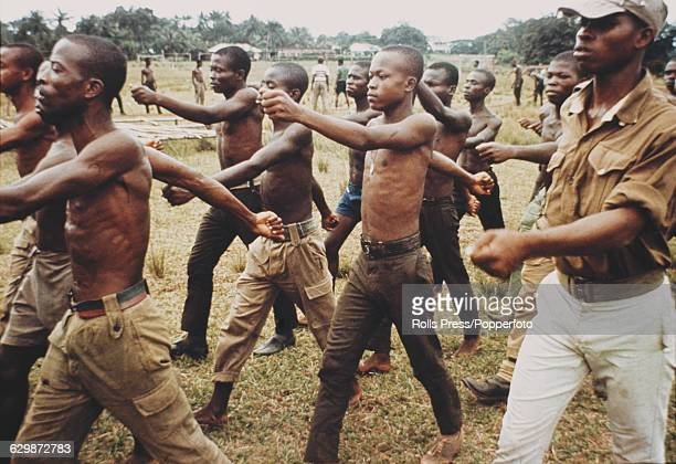 View of young men undergoing basic training before being sent to fight in the Nigerian Biafran civil war in Nigeria in August 1968 Members of the...