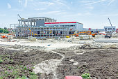 Landscape transform into urban area with machinery, people are working. View on construction site.