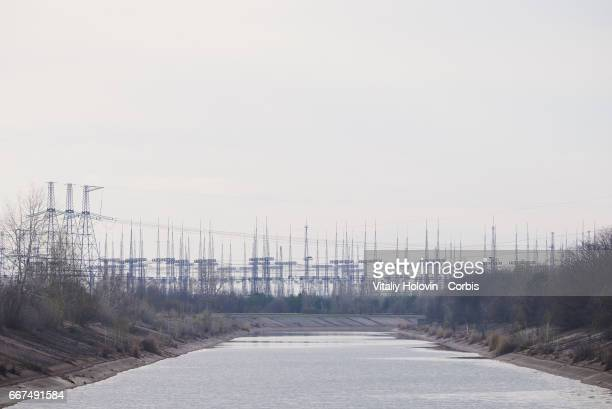 A view on front of the electrical pylon's field of the Chernobyl nuclear power plant in the Exclusion Zone Ukraine April 5 2017 The Chernobyl nuclear...