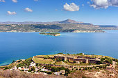 View on sea bay and old Venetian fortress in Aptera on Crete island, Greece