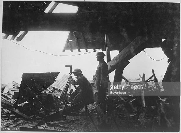 View on the roof of the Crown Prince's observatory showing Americans using observation instruments left behind by the Germans in their hasty retreat...