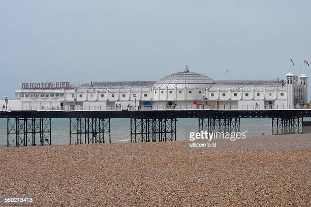 View onto the pebble stone beach and the Brighton Pier from the Volks Electric Railway Brighton East Sussex England UK on