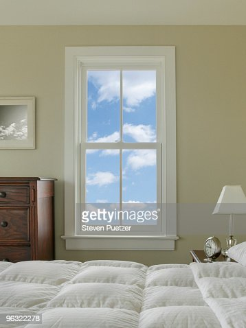 view out bedroom window with blue sky and clouds stock photo getty