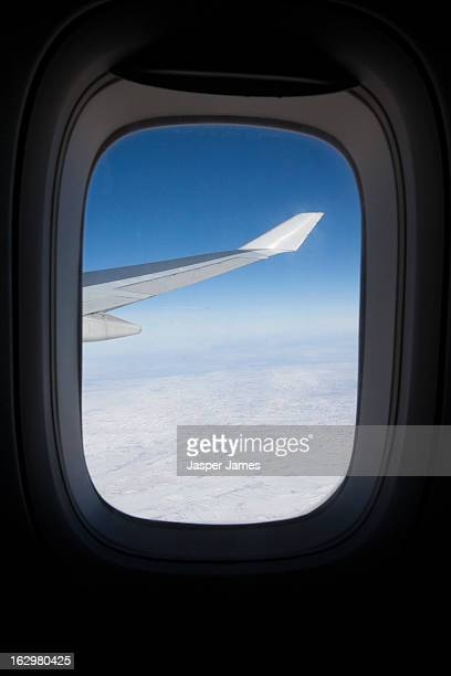 view out of the window of a flying plane