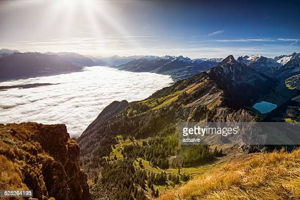View over Alpstein and Rhine Valley full of fog