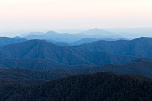 A mountain range layered by fog and morning light in the Great Dividing Range, Australia.