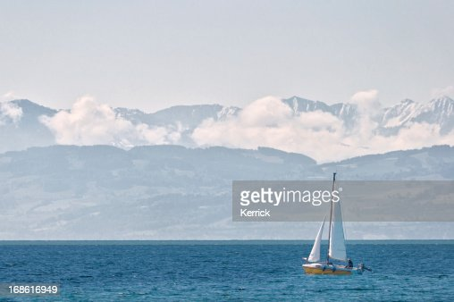View over Lake Constance to the alps covered with snow