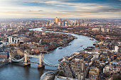 View over London: from the Tower Bridge along the Thames to Canary Wharf during sunset time