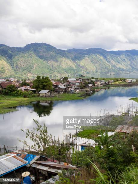 TAKENGON SUMATRA INDONESIA A view over small backyard fish farms in Takengon a small town sitting beside a large highland lake and known for it's...
