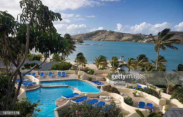 View over swimming pools and bay at Caribbean resort