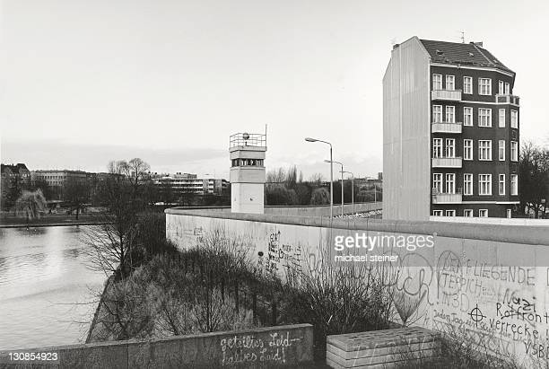 View over the Berlin Wall in 1985, detached house next to a watchtower adjacent to the inner German border, known as the Death Strip, Berlin, Germany, Europe