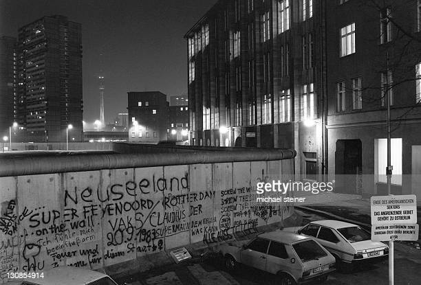 View over the Berlin Wall in 1985, towards the TV Tower at Alexanderplatz in East Berlin, at night, Berlin, Germany, Europe