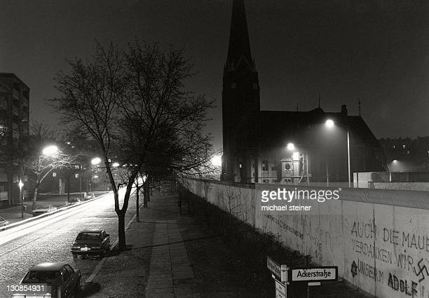 View over the Berlin Wall in the winter of 1985, Bernauer Strasse with the Church of Reconciliation shortly before the demolition on the border strip, Berlin, Germany, Europe