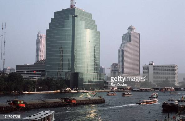 View over the Chao Phraya River known as the River of Kings towards the striking glass and steel structure of the Communications Authority of...