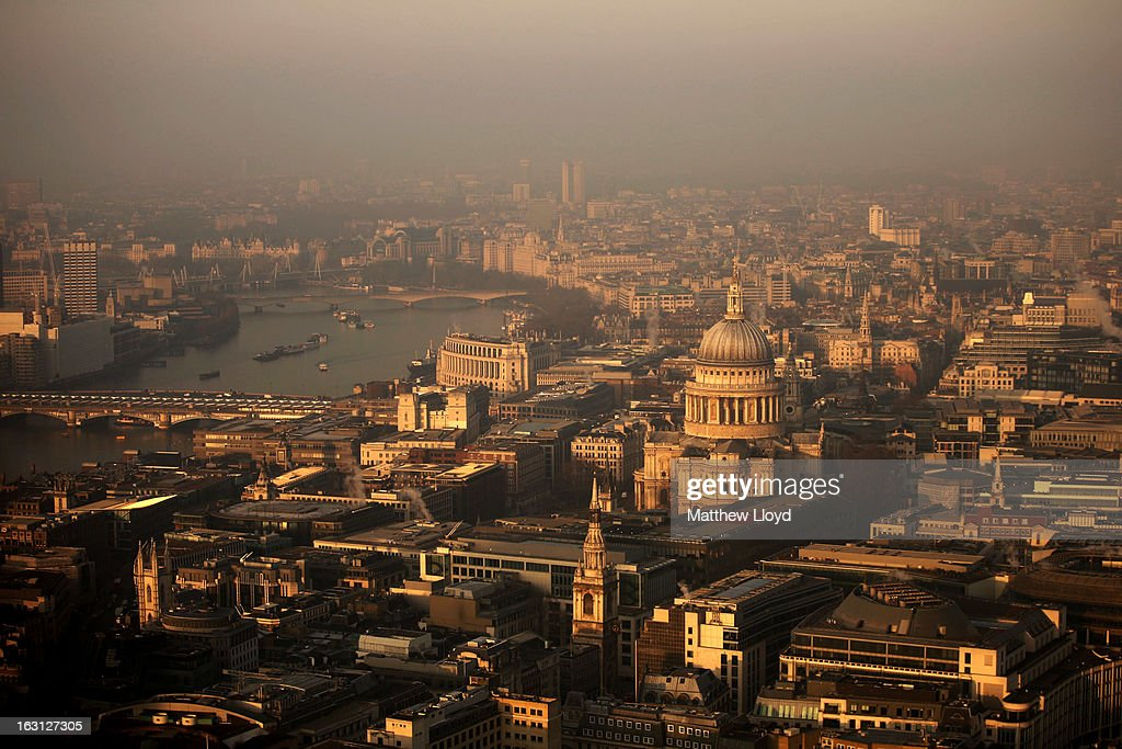 A view over the financial district and St Paul's Cathedral towards the west of the city at sunrise on March 5, 2013 in London, England. The recent construction of numerous tall buildings on the London skyline has been controversial due to concerns that views of historic landmark buildings, such as St Paul's cathedral, are being obscured.