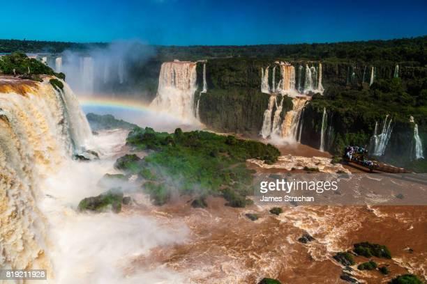View over the Garganta del Diablo (Devil's Throat), Iguazu Falls (UNESCO World Heritage Site) from Brazilian side, with visitors on walkway in middle, Iguazu, Brazil